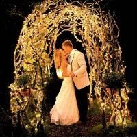 The newlyweds kiss under the arbor here at Glen-Ella Springs Inn in North Georgia.