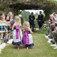 Little Flower Girls walk on the aisle at a wedding ceremony in Glen-Ella Springs Inn in Clarkesville, GA