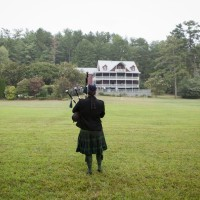 A Scotsman playing beautiful music with his pipes during a wedding at Glen-Ella Springs Inn, a romantic wedding venue in North Georgia.