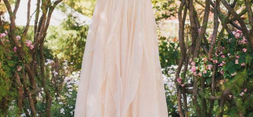 wedding dress hanging in gardens