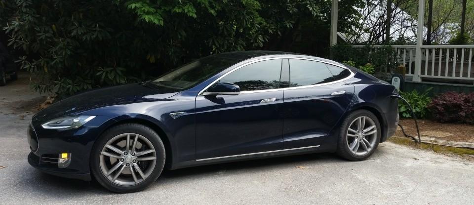 tesla charging station charges a guest car at Glen-Ella Springs Inn