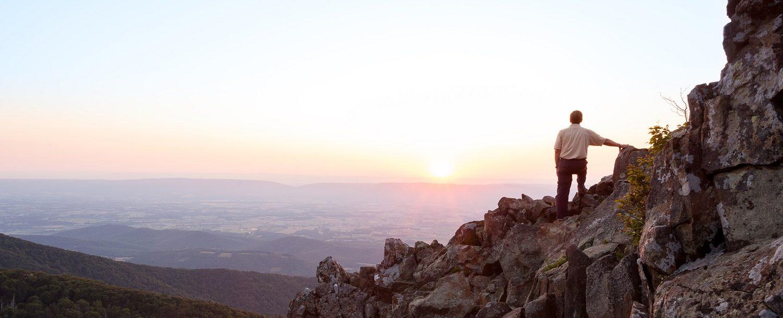 man standing on Blue Ridge Mountain rocks