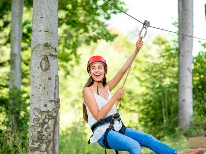 Girl riding on a zip line, one of the best things to do in Clarkesville GA