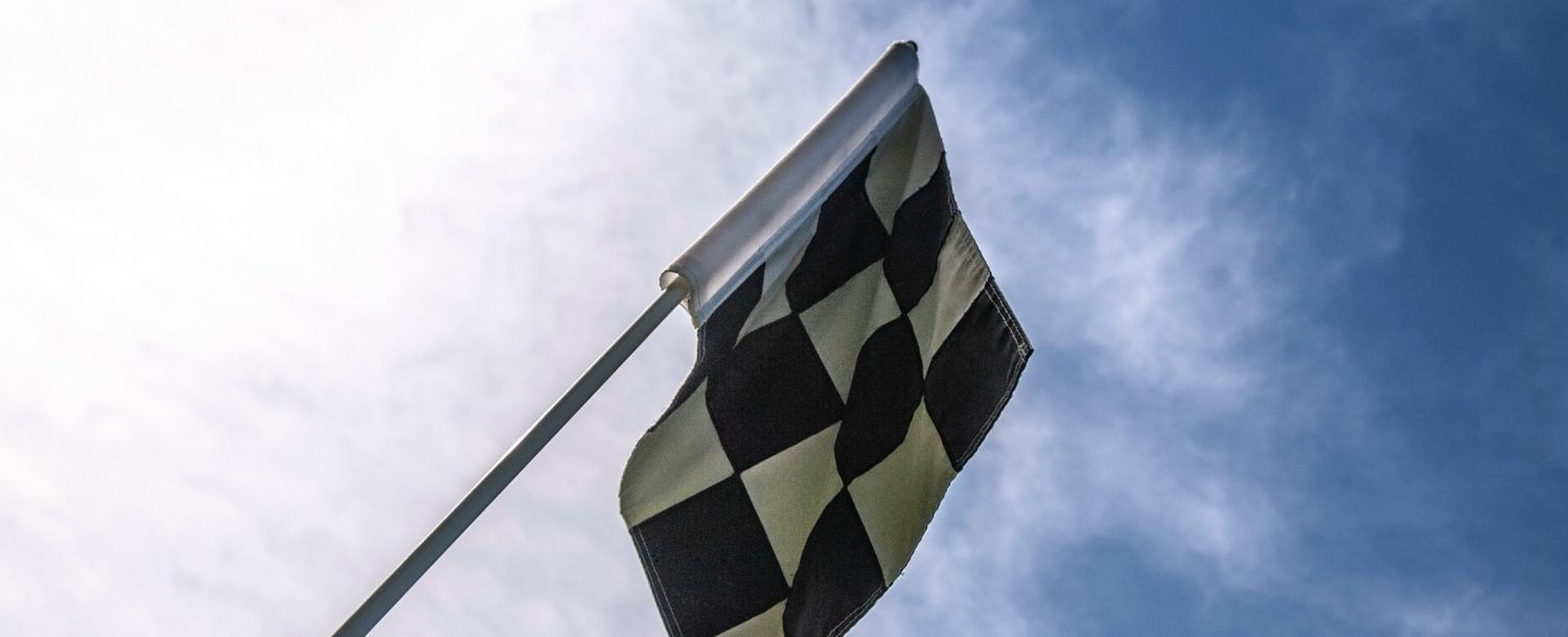 checkered race flag in the sky