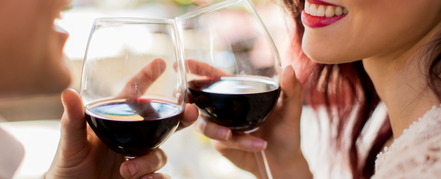 couple celebrating Valentine's Day with a glass of red wine