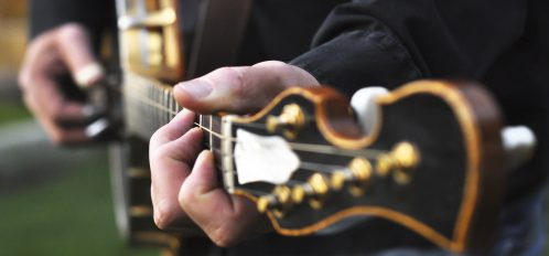 Fingers Playing a Banjo